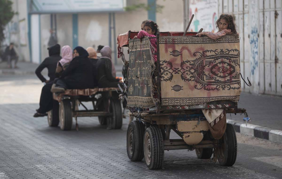 Palestinians flee their homes after overnight Israeli heavy missile strikes on their neighborho ...
