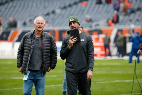Green Bay Packers' Aaron Rodgers, talk to ESPN's Kenny Mayne before an NFL game against the Chi ...