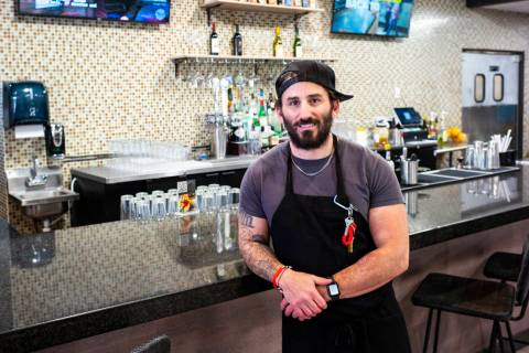 Matthew Meyer, owner and chef at Served Global Cuisine, poses for a portrait in the new sushi b ...