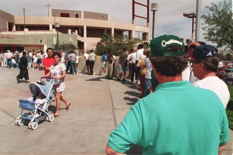 Baseball fans line up to purchase tickets for the Oakland A's opening homestand at Cashman Fiel ...