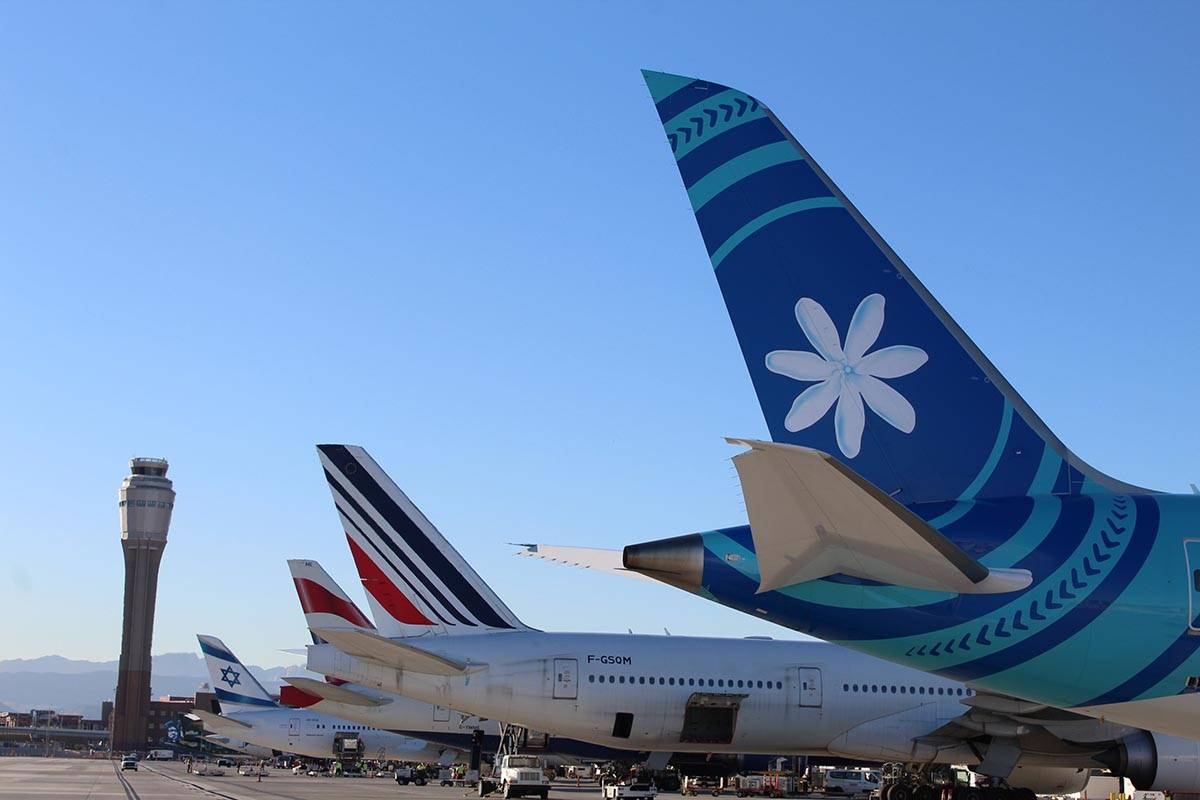The tails of several international air carriers on Monday, Jan. 6, 2020, as extra flights arriv ...