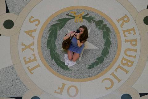 A visitor stops in the rotunda at the State Capitol to take photos, Thursday, May 20, 2021, in ...