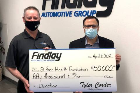 Findlay Automotive Group CFO Tyler Corder, left, makes a $50,000 donation to St. Rose Dominican ...