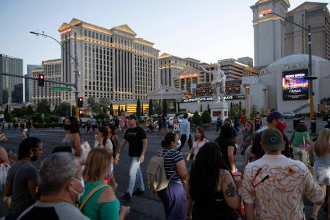 Some visitors to the Las Vegas Strip outside Caesars Palace on Thursday, May 13, 2021, in Las V ...