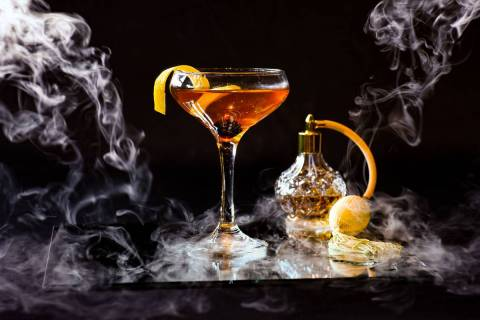 The Smoke and Mirrors spirit-driven cocktail is inspired by the classic Manhattan and is made w ...