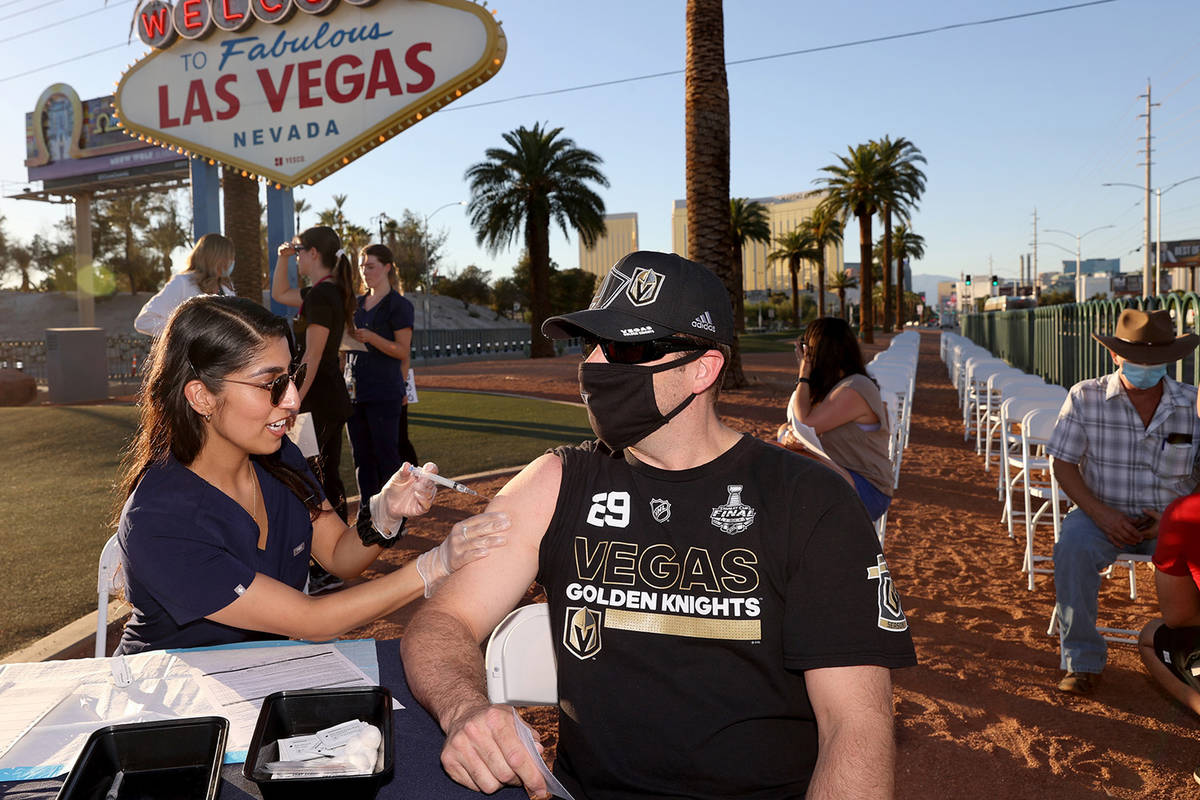 Touro University Physician Assistant student Aanchal Shahani gives Josh Cyriacks of Henderson a ...