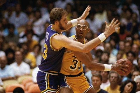 Mark Eaton of the Utah Jazz seems to have Los Angeles Lakers player Kareem Abdul-Jabbar in hand ...