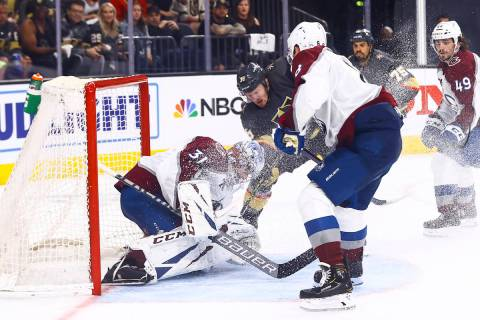 Golden Knights' Patrick Brown (38) fights to get the puck past Colorado Avalanche goaltender Ph ...