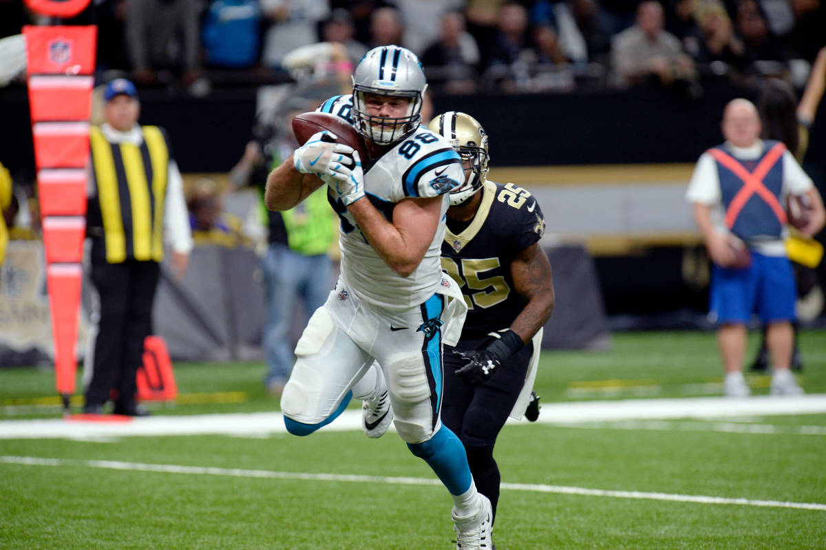 Carolina Panthers tight end Greg Olsen (88) pulls in a touchdown reception in front of New Orle ...