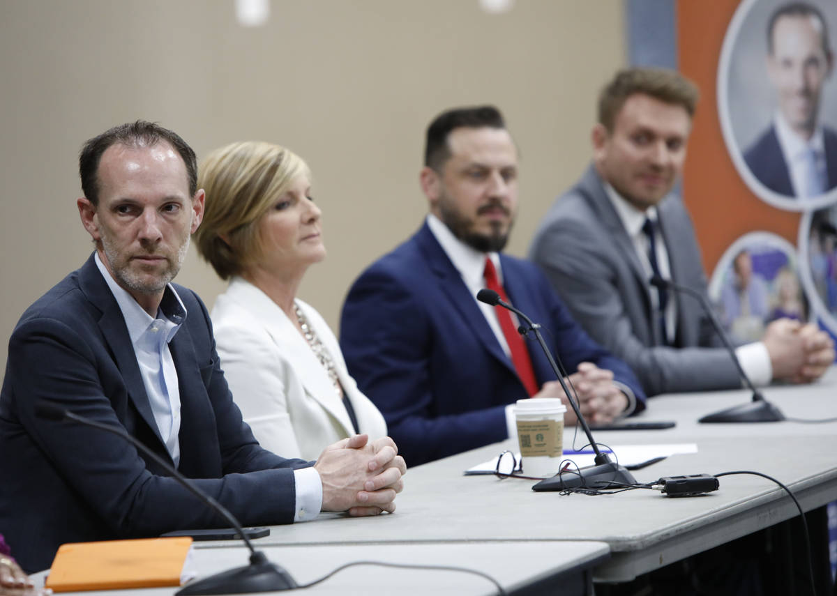 Clark County Commissioner Justin Jones, left, takes part in a Housing Resource Talk at Desert B ...