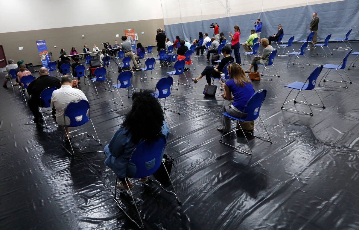 People attend a Housing Resource Talk at Desert Breeze Community Center in Las Vegas, Wednesday ...