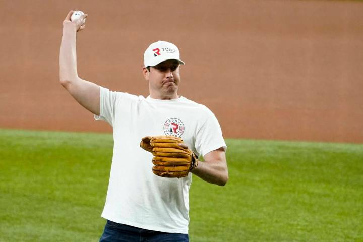 NASCAR driver Kyle Busch throws out the ceremonial first pitch before a baseball game between t ...