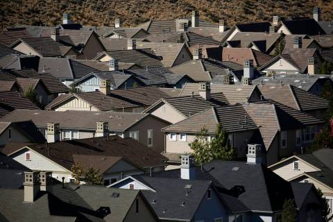 Homes fill a small a valley on the outskirts of Reno in 2018. (AP Photo/John Locher)