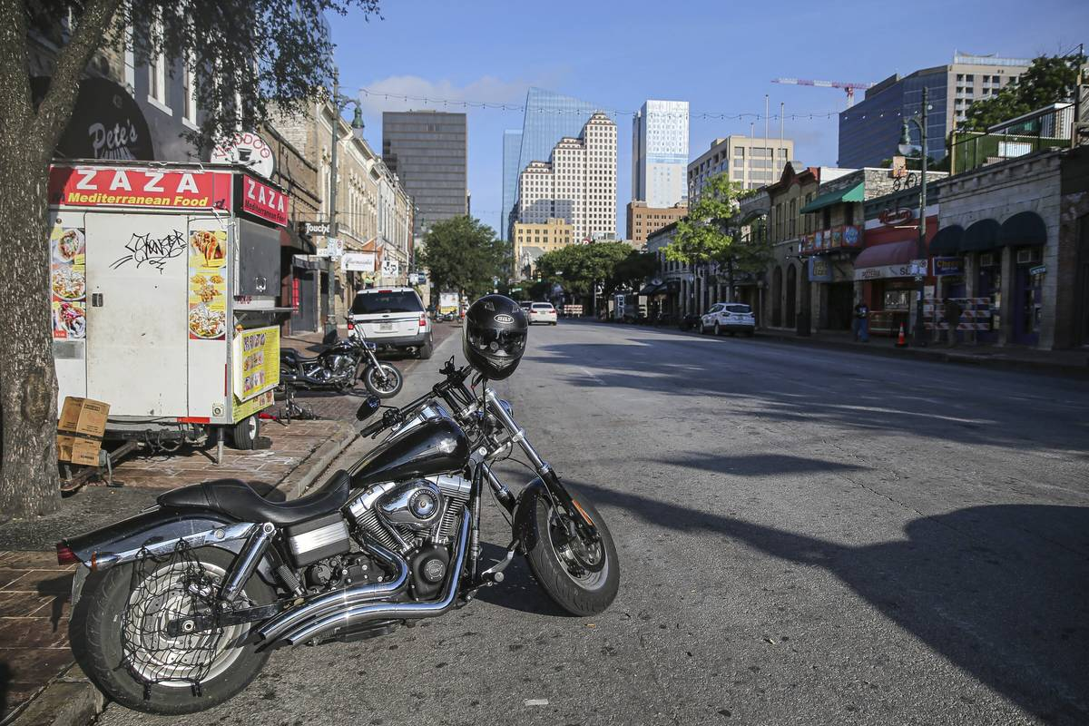 Some abandoned bikes are parked on the streets after a early morning shooting on Saturday, June ...