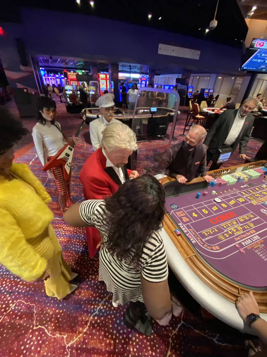 Virgin Group founder Richard Branson is shown at a Virgin Hotels Las Vegas craps table, Friday, ...