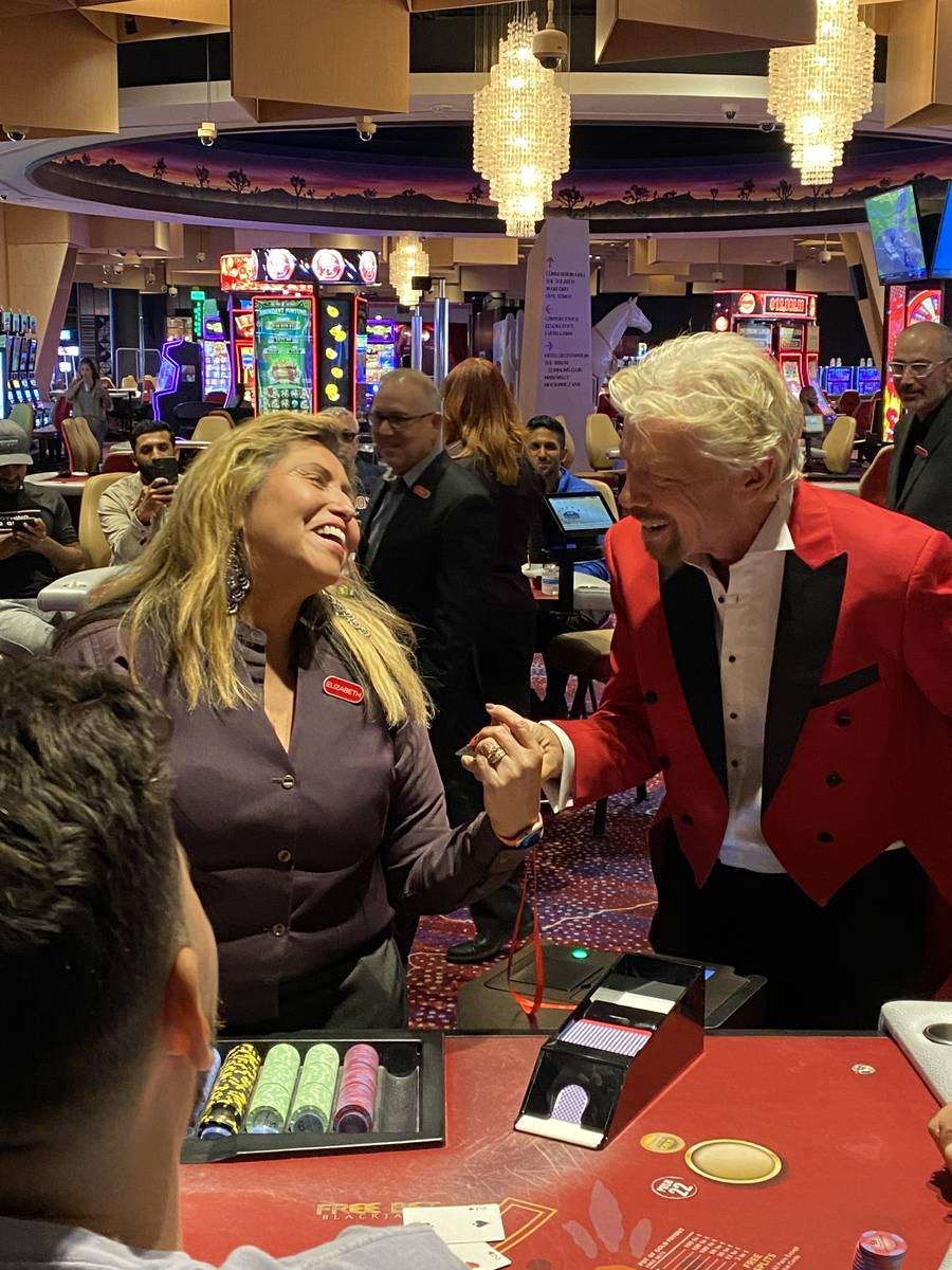 Virgin Group founder Richard Branson is shown with a blackjack dealer at Virgin Hotels Las Vega ...