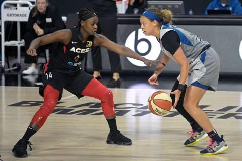 Las Vegas Aces guard Sugar Rodgers (14) defends against Minnesota Lynx guard Rachel Banham, rig ...