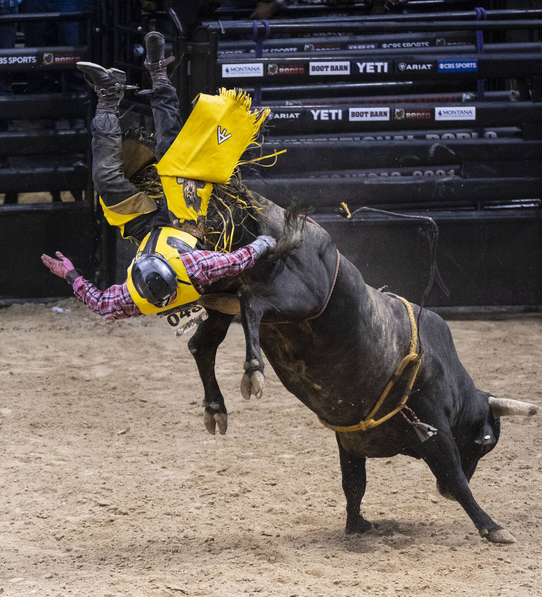 Tank Adams, of Shawnee, Okla., is thrown while atop of Red Velvet as he competes Bull Riding at ...