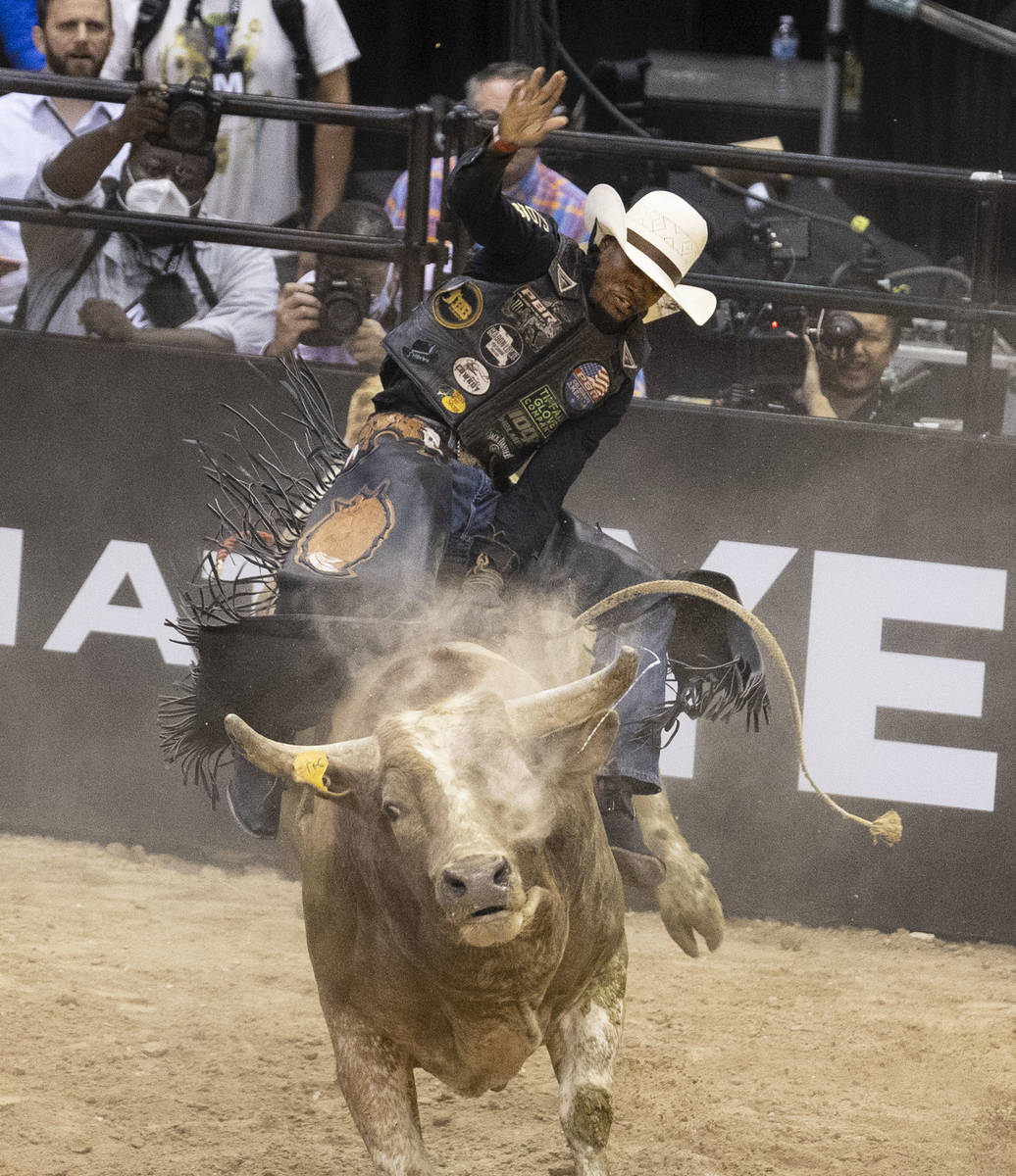 Winner of Bull Riding competition, Ouncie Mitchell, of Houston, Texas., rides Romeo while comp ...
