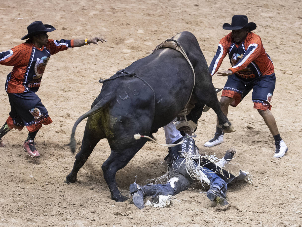 Ezekiel Mitchell, of Rockdale, Texas., is thrown while atop of Machin as he competes Bull Ridin ...