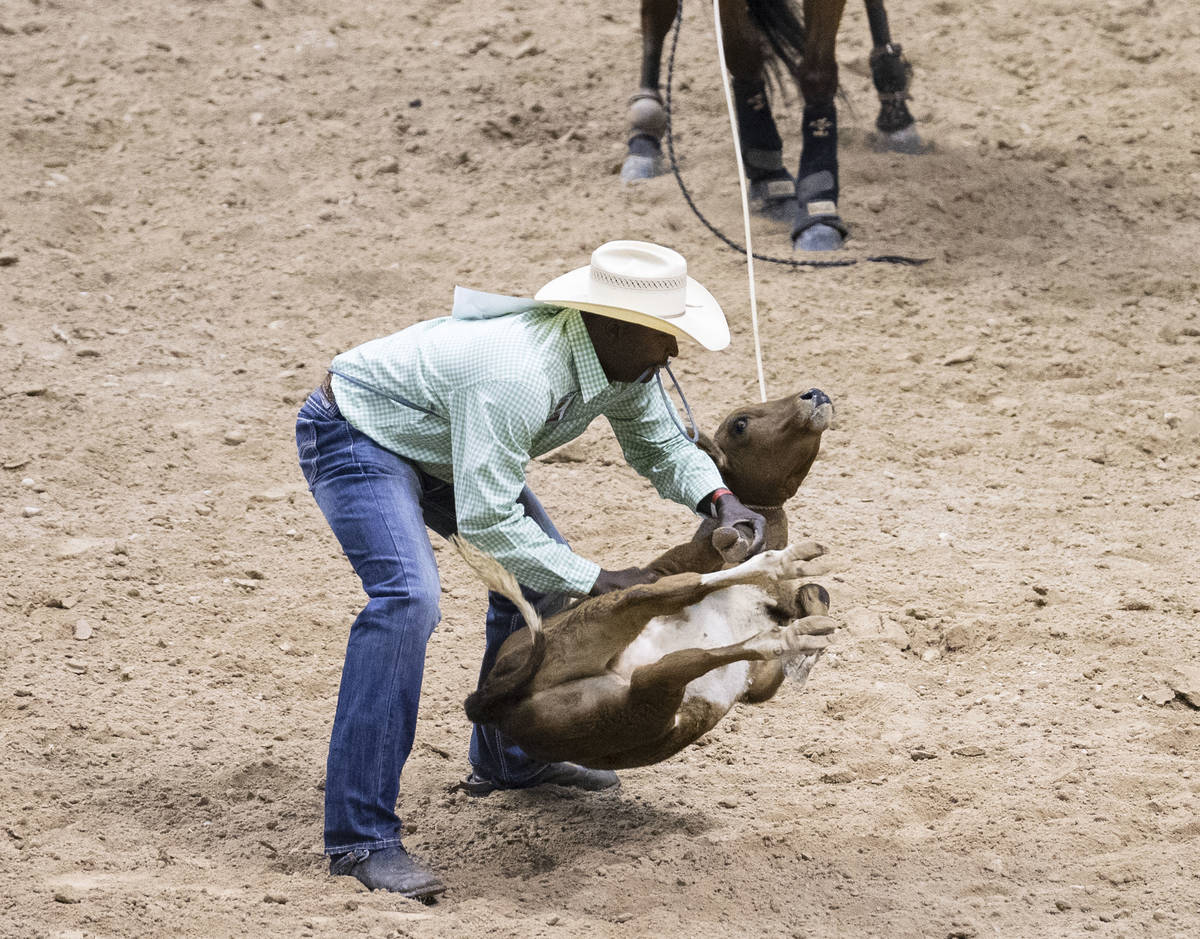 Chris Rolling, of Huntsville, Texas, participates in calf roping competition at the Bill Picket ...
