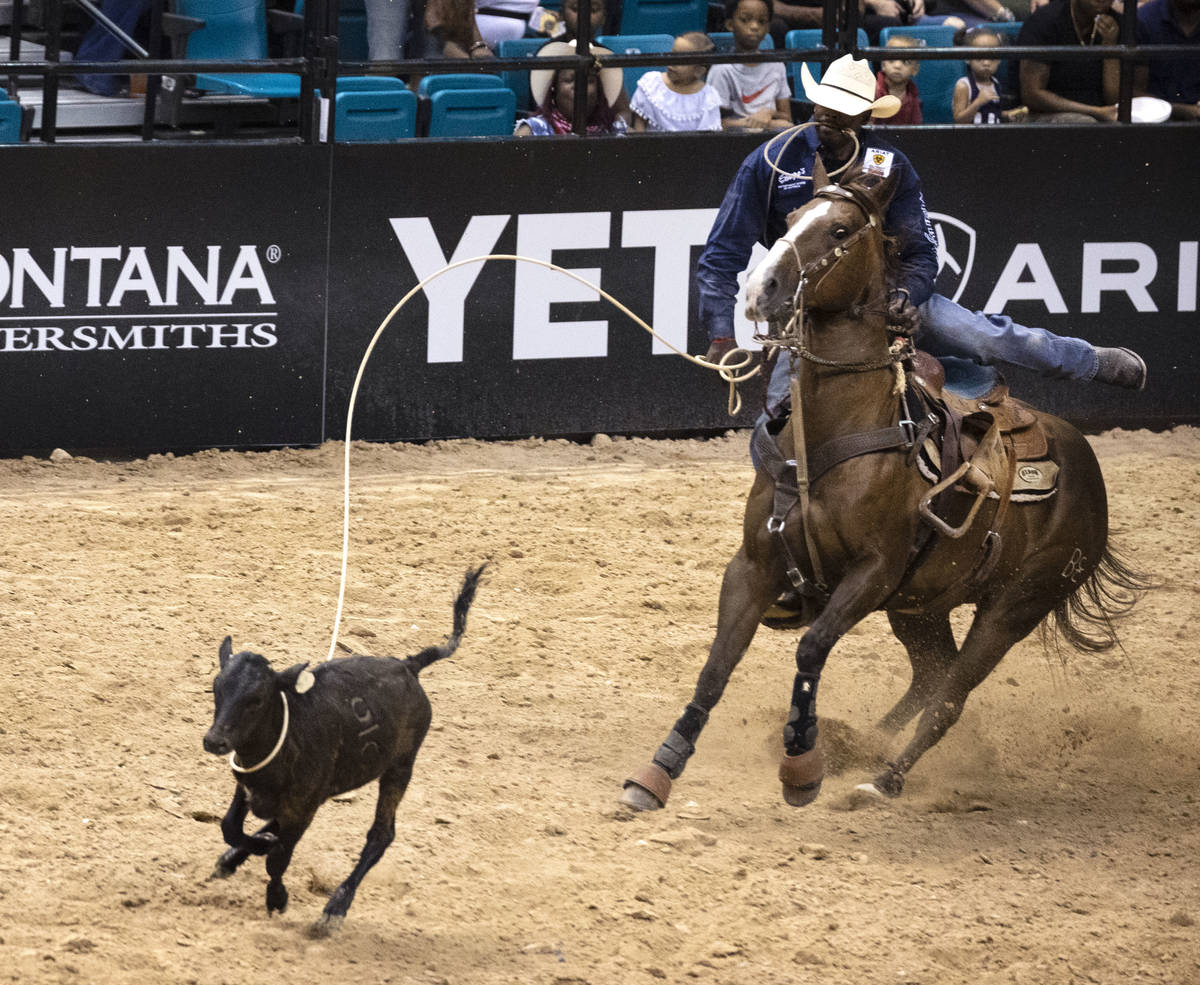 Jeremy Burkhalter, of Houston, Texas, participates in calf roping competition at the Bill Picke ...