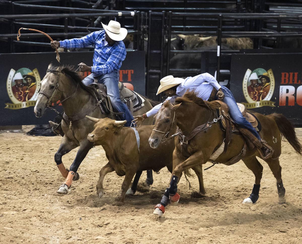 Azja Bryant, of Huntsville, Texas, participates in calf wrangling competition at the Bill Picke ...