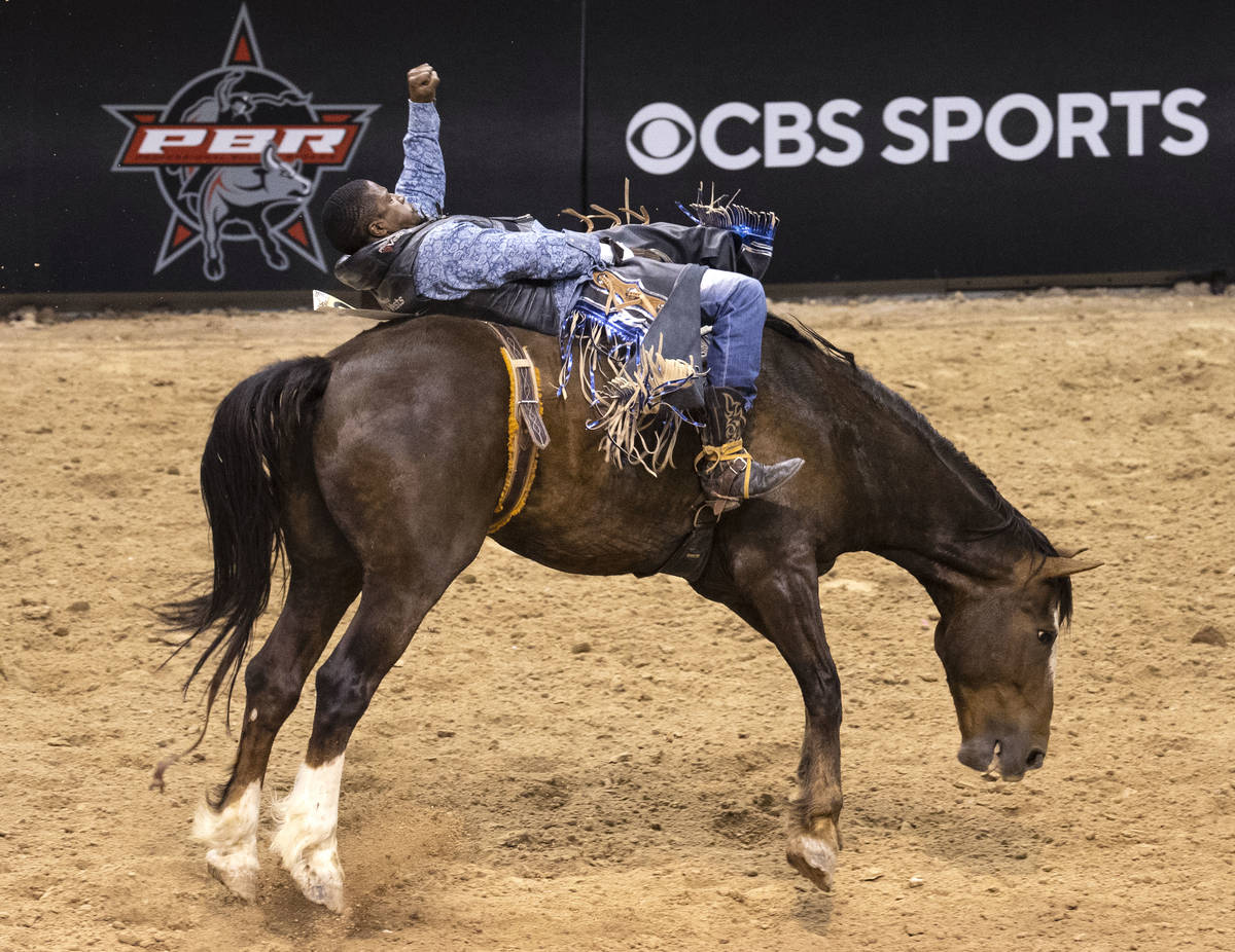 Patrick Liddle, of Watts, Calif., participates in bareback riding competition at the Bill Picke ...