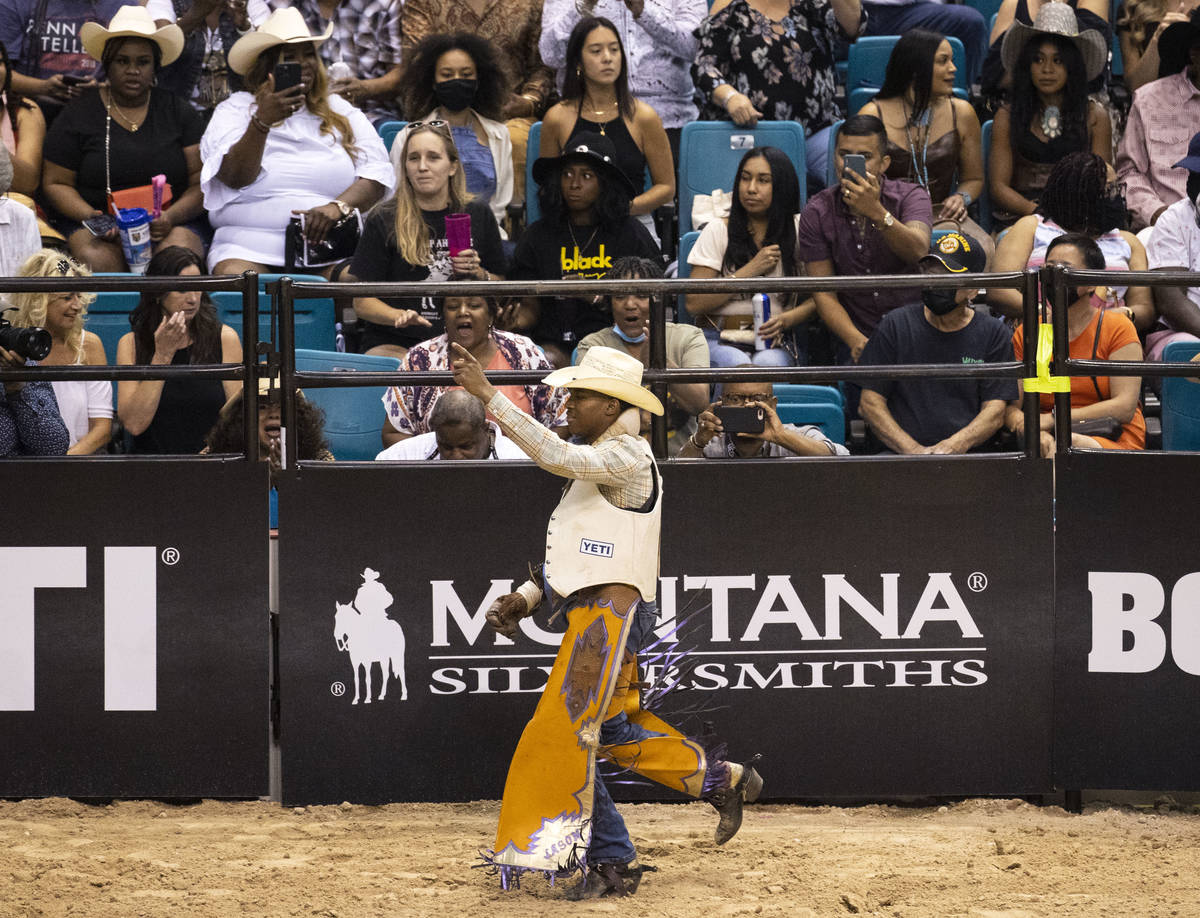 Harold Miller, of Liberty S.C., reacts after completing the bareback riding competition at the ...