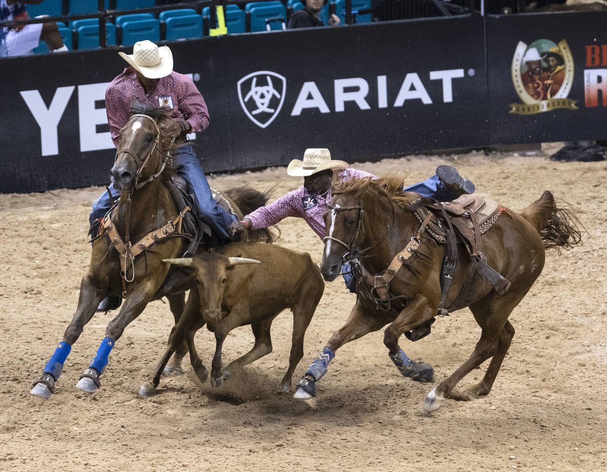 Troy Ford attempts to wrangle a calf at the Bill Pickett Invitational Rodeo final, the nation's ...