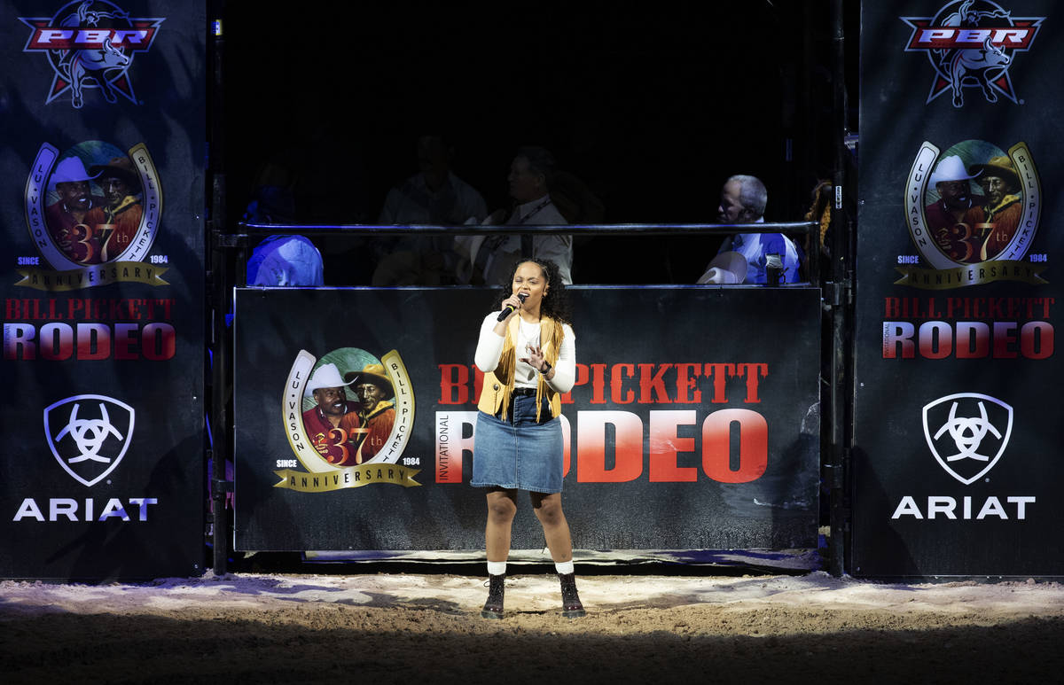 Tiffany LeMay sings the National Anthem at the Bill Pickett Invitational Rodeo final, the natio ...