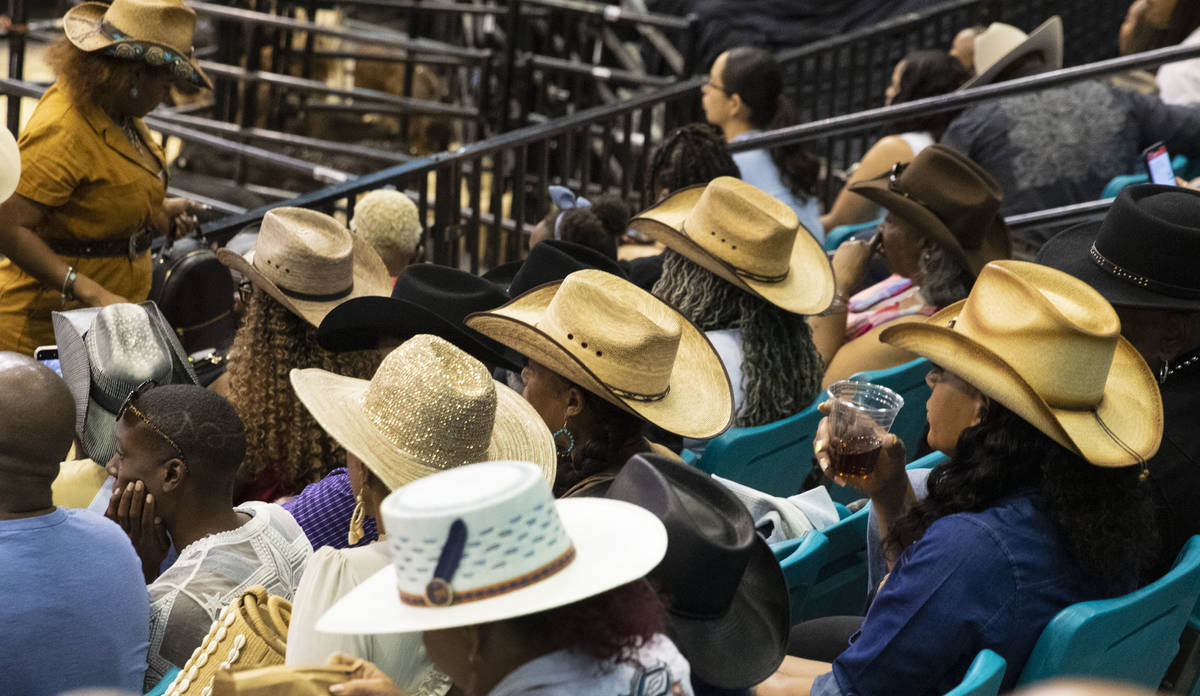 People watch the Bill Pickett Invitational Rodeo, the nation's only touring black rodeo competi ...