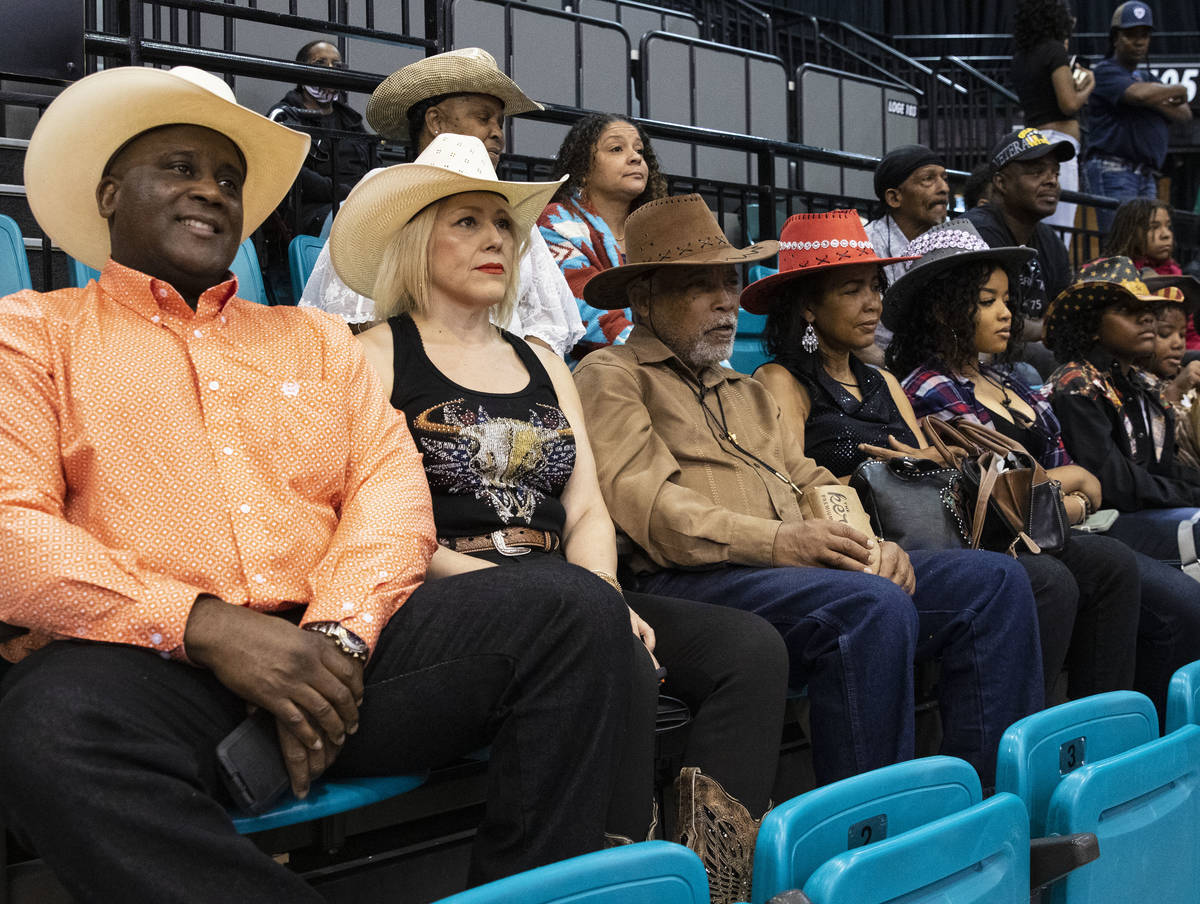 People, including Victor Locklin, left, Judy Santos, Darrell Porter and his wife Wanda watch th ...
