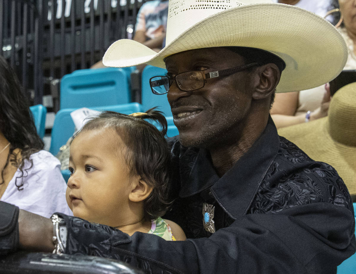 Darrel Turman, of Lons Angeles, watches the Bill Pickett Invitational Rodeo, the nation's only ...