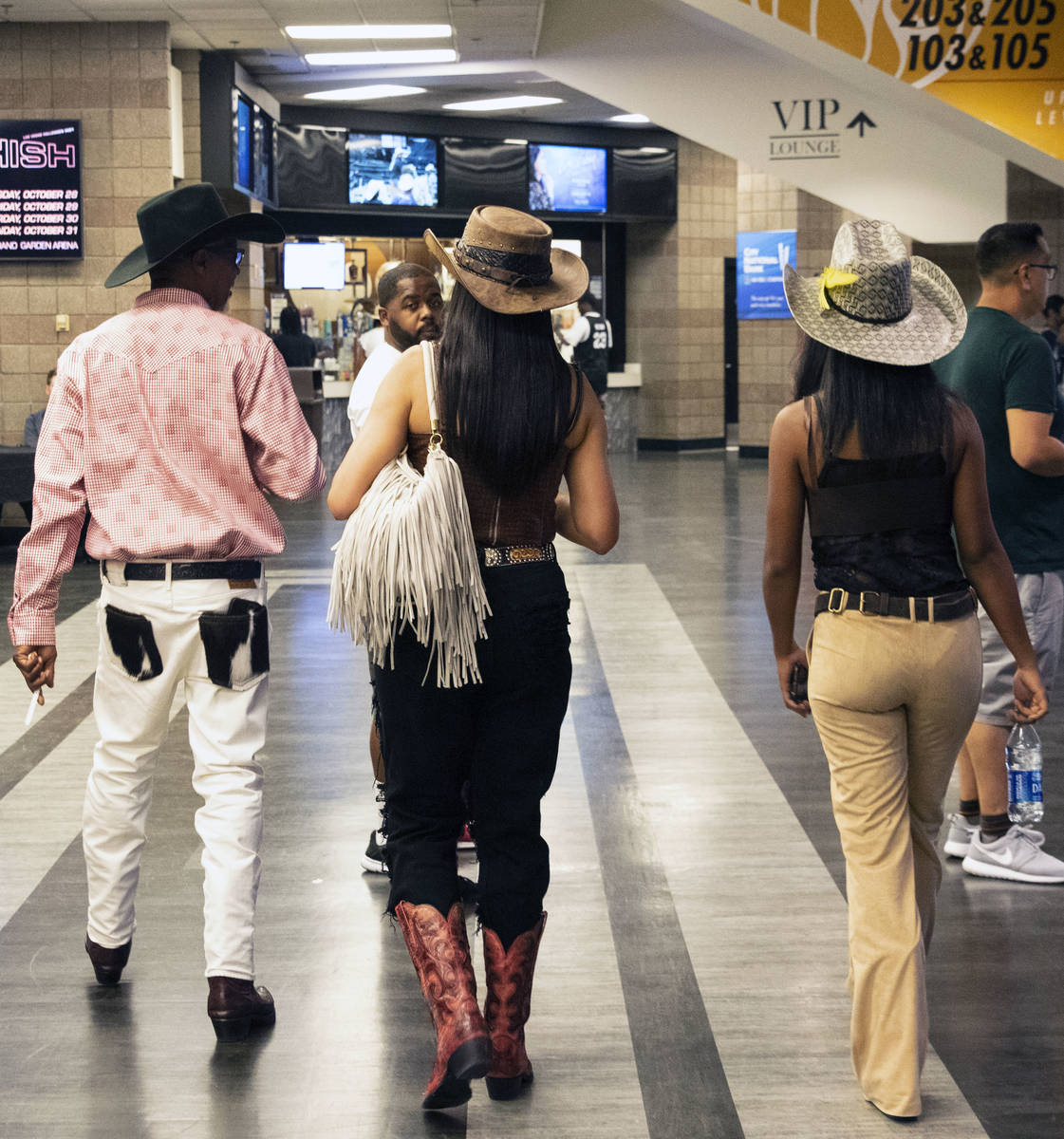 People arrive to watch the Bill Pickett Invitational Rodeo, the nation's only touring black rod ...