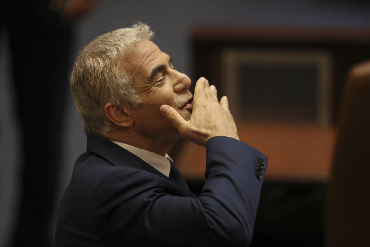 Israeli politician Yair Lapid of the Yesh Atid party sends greetings during a Knesset session i ...
