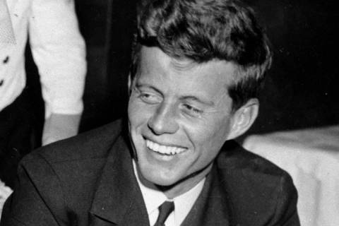 John F. Kennedy smiles at the Stork Club in New York. (AP Photo/File)