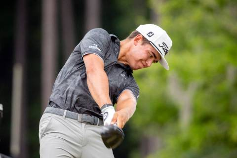 Garrick Higgo, of South Africa, hits off the third tee during the final round of the Palmetto C ...