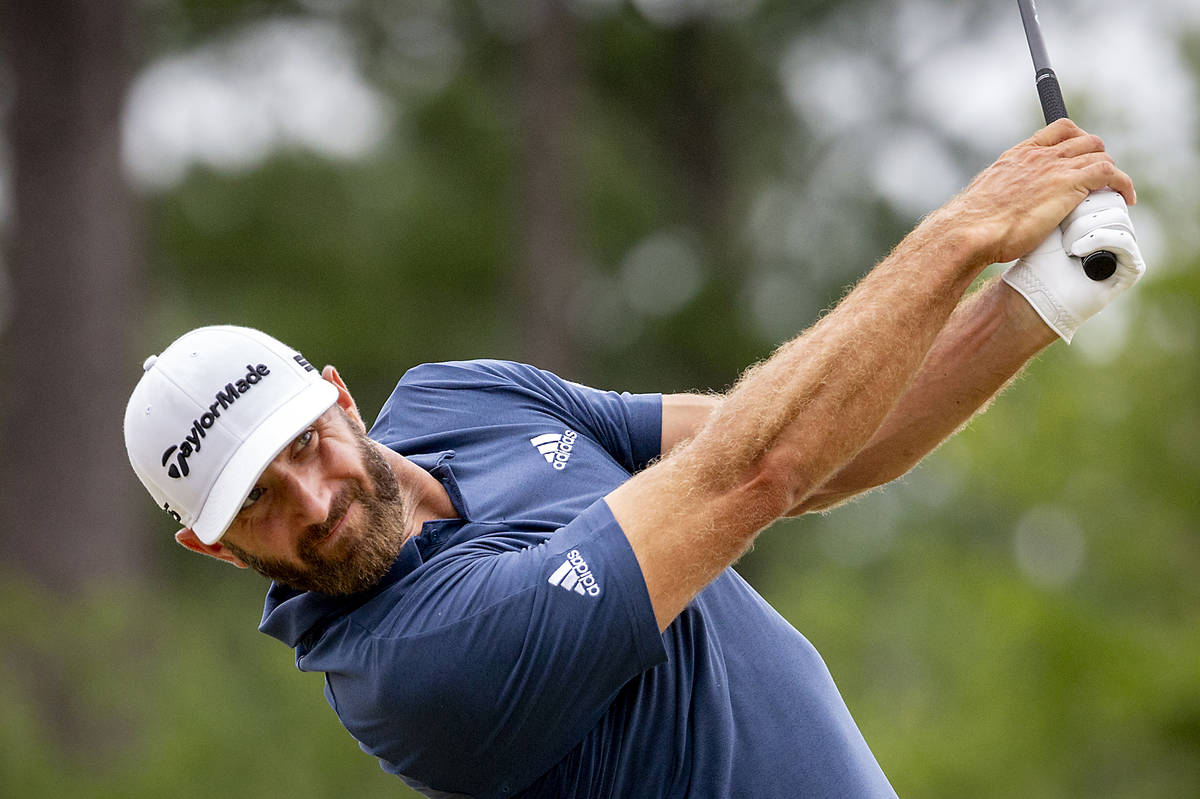Dustin Johnson watches his drive off the third tee during the final round of the Palmetto Champ ...