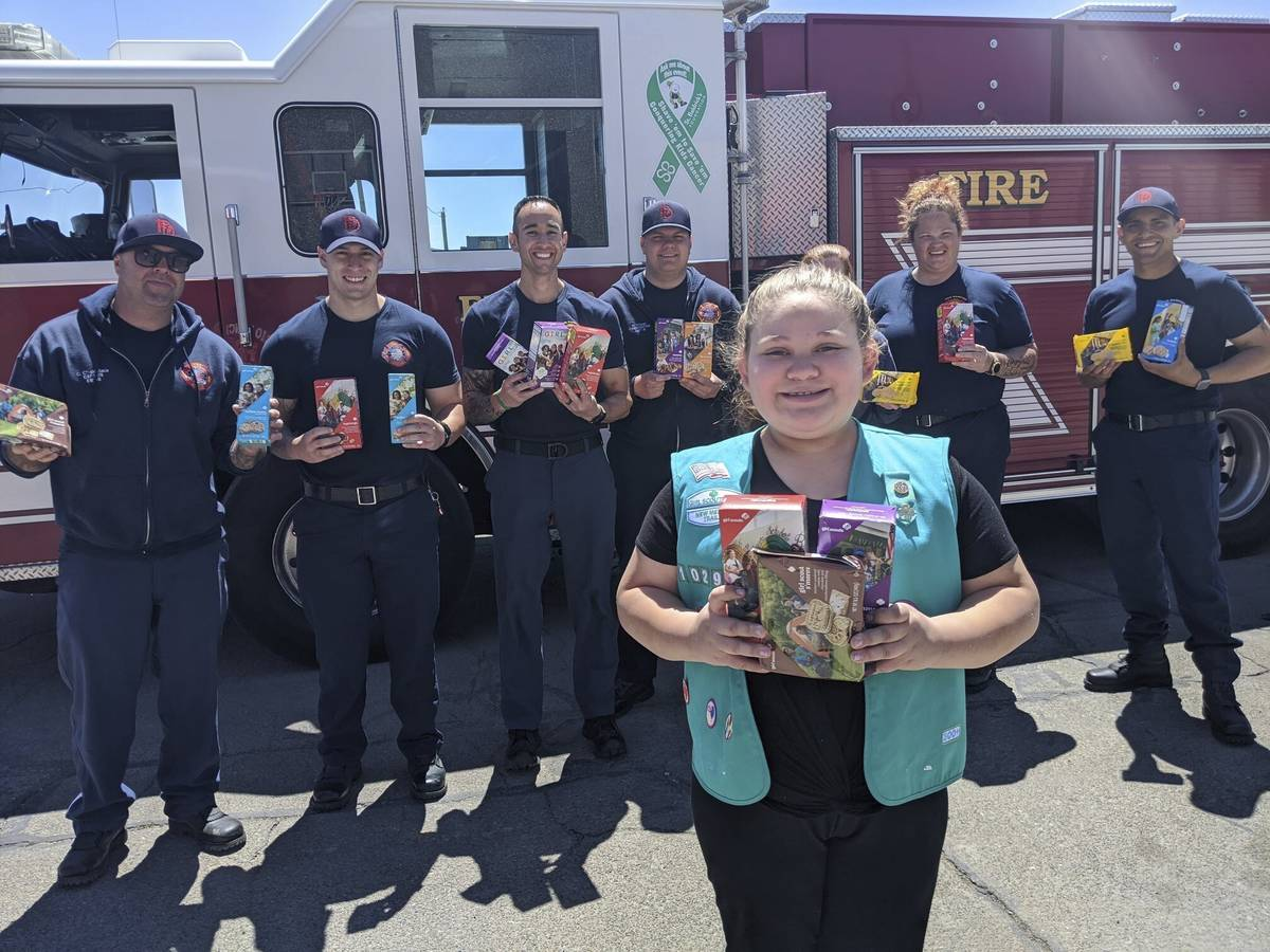 This undated photo provided by Girl Scouts of New Mexico Trails shows a scout donating cookies ...