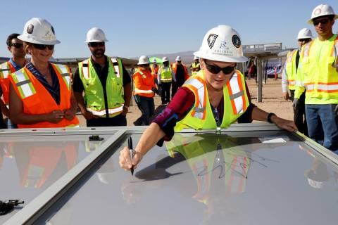 U.S. Energy Secretary Jennifer Granholm tours signs a solar module at Townsite solar facility i ...