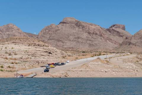 Vehicles line up on the South Cove boat launch ramp at the eastern end of Lake Mead in this pho ...