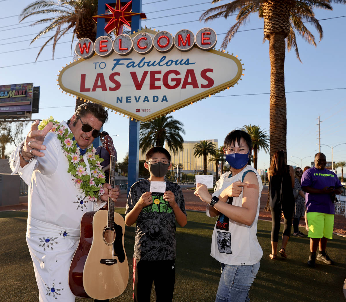 Elvis impersonator Mark Edward Rumpler poses withIzumi Kimoto, 44, and her on Joe, 12,&#x ...