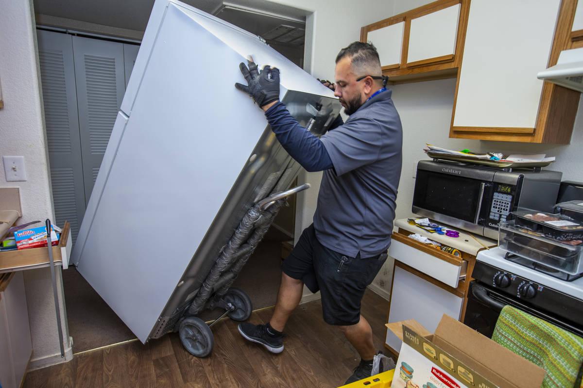 Lowe's employee Albert Vazquez delivers one of the 98 fridges at Bonanza Pines Senior Living be ...