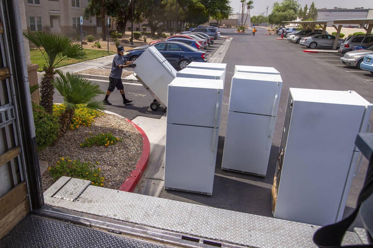 Lowe's employee Romanldo Lazaro prepares to take away some of the 98 old fridges at Bonanza Pin ...