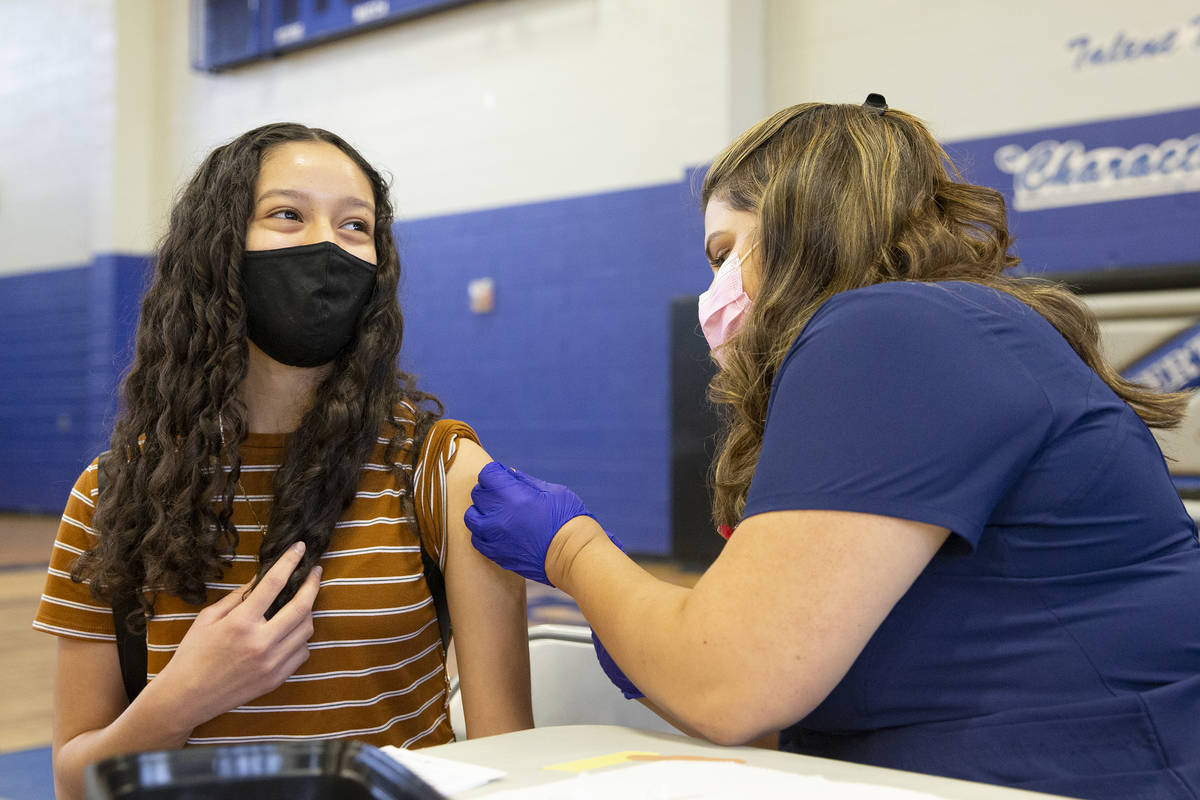 High school sophomore Angie Guerrero, 15, smiles after receiving the Pfizer COVID-19 vaccine fr ...