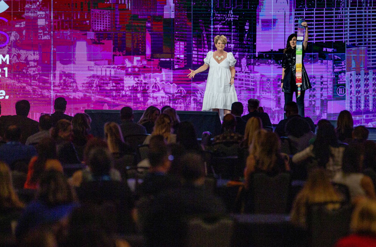 EmceeSquared hosts Tami Evans, left, and Christine Cashen entertain attendees during the Meetin ...