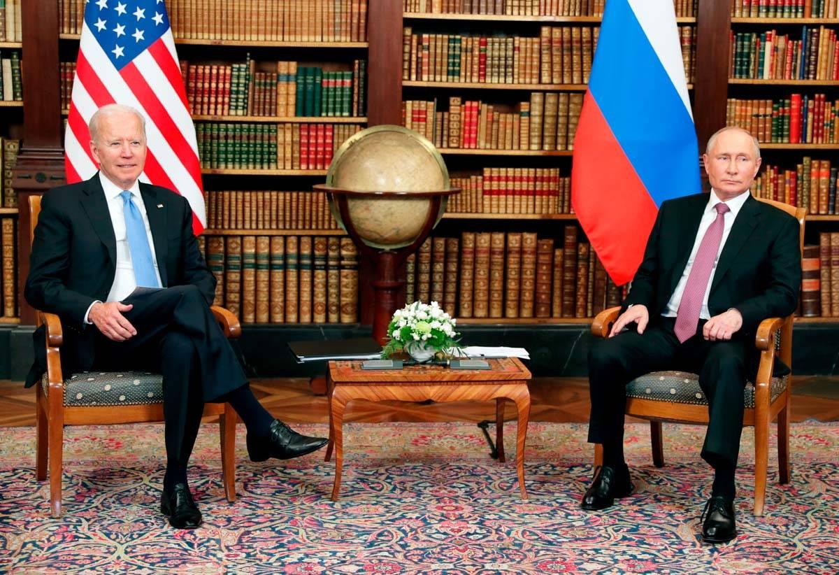 U.S President Joe Biden, left, and Russian President Vladimir Putin pose for media during their ...