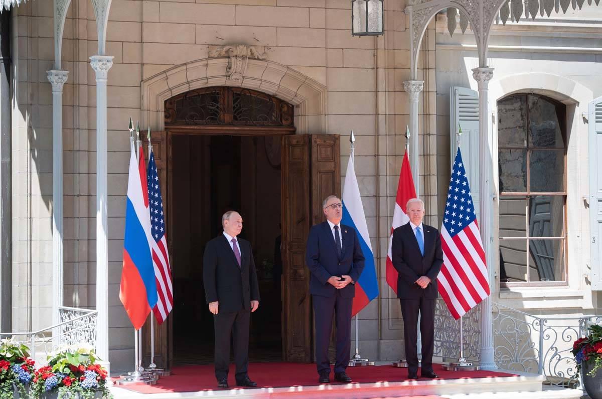 Swiss President Guy Parmelin, center, greets President Joe Biden, right, and Russian President ...