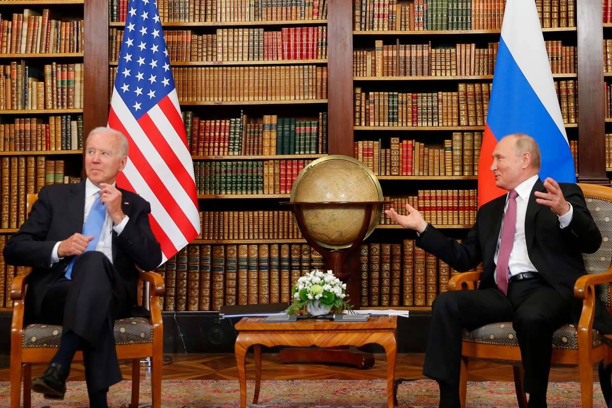 U.S. President Joe Biden, left, and Russia's President Vladimir Putin, right, meet for the U.S. ...